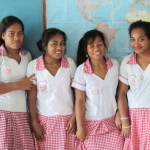 old uniform on left, new uniforms worn by other three girls