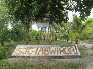 school sign by lagoon