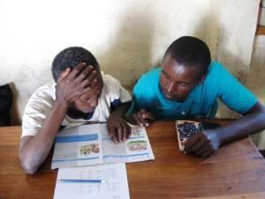 Julius teaching Teresia to read