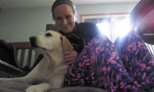 Sarah cuddling with her dog Morgan
