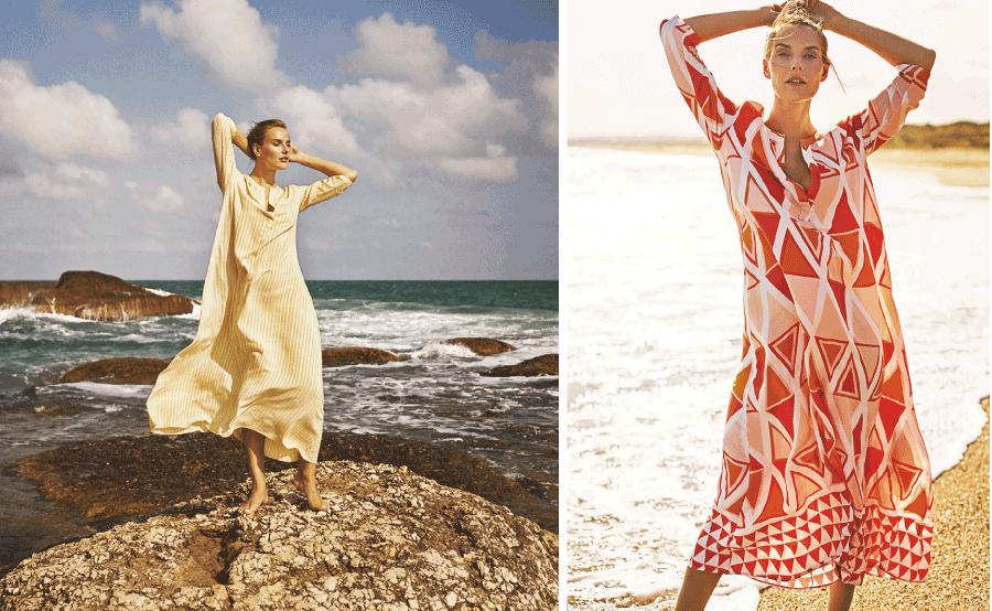 VONsociety: Model trägt eine wadenlange van Dalsky Tunika mit 3/4 Arm aus gelb-weiß gestreiftem Stoff. Die junge Frau steht auf einem Felsen am Meer
