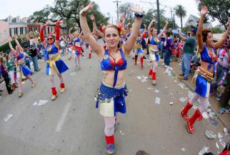 A member of the Organ Grinders dances her way down St. Charles Avenue during a Mardi Gras parade in New Orleans, Louisiana February 15, 2015. REUTERS/Jonathan Bachman (UNITED STATES - Tags: SOCIETY) - RTR4PPJH