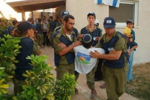 Israeli soilders force out residents from Gush Katif in August of 2005