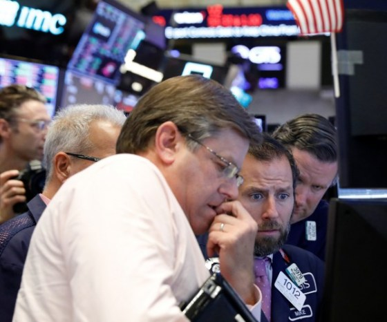 Traders work on the floor of the New York Stock Exchange (NYSE) in New York, U.S., October 11, 2018. REUTERS/Brendan McDermid