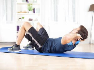 Man doing situps in living room