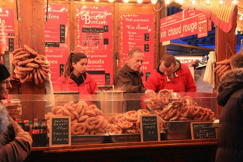 "Food stand offering ""Beignet Bretzels"" (Pretzel Donuts) and Vin Chaud (Gluwein) in Strasbourg, the Alsace region of France which borders Germany, taken by Diann Corbett, 12/2014."