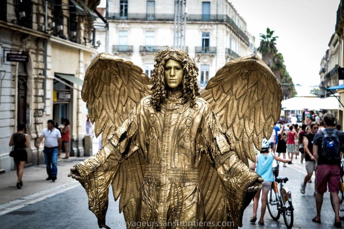 A street artist dressed as a golden angel on Rue de la Loge - Montpellier, France