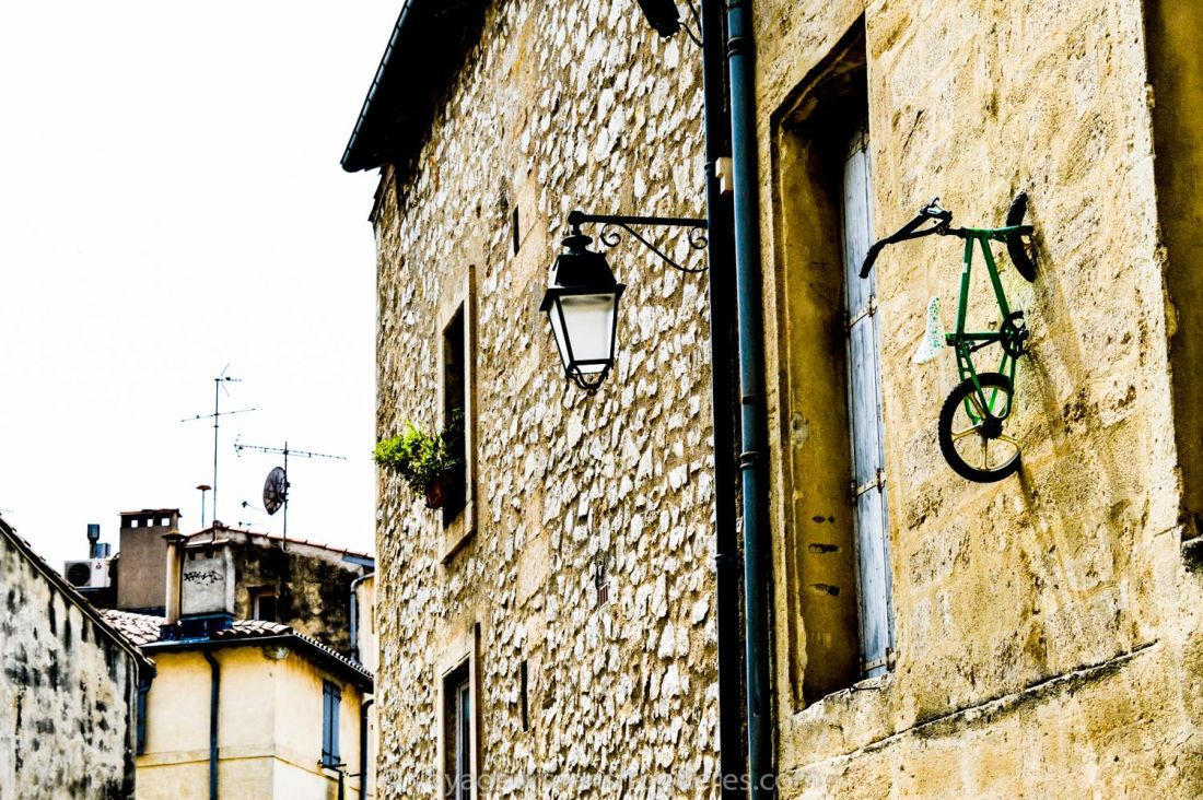 Bike embedded in a wall in the Ecusson - Montpellier, France