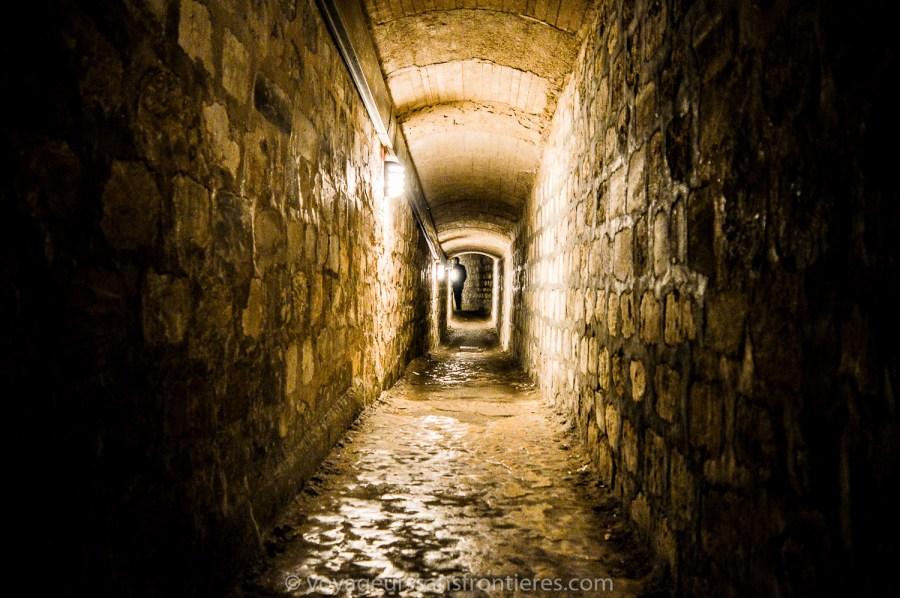 A spooky hallway at the Paris catacombs - Paris, France