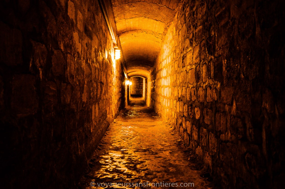A spooky hallway at the Paris catacombs - Paris, France