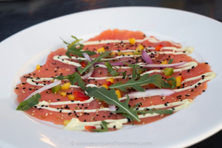 Salmon carpaccio at Suiderstrand on the Kijkduin beach - The Hague, Netherlands
