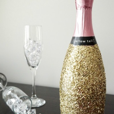 Glitter-covered champagne bottles - for parties, weddings, special occasions. -- Emily Kennedy for VRAI Magazine