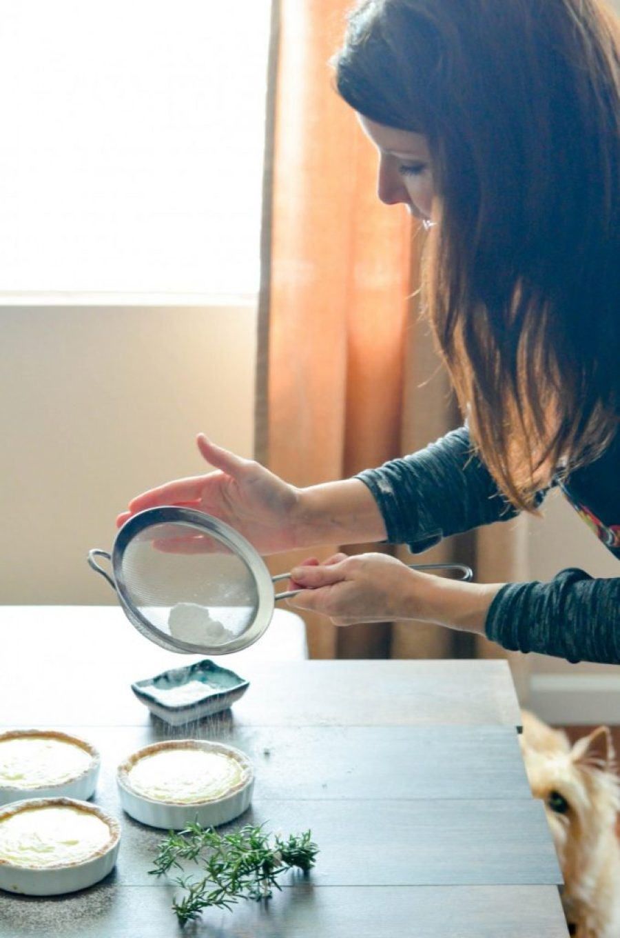 Karista working on Lemon Rosemary Tarts with Tank observing_
