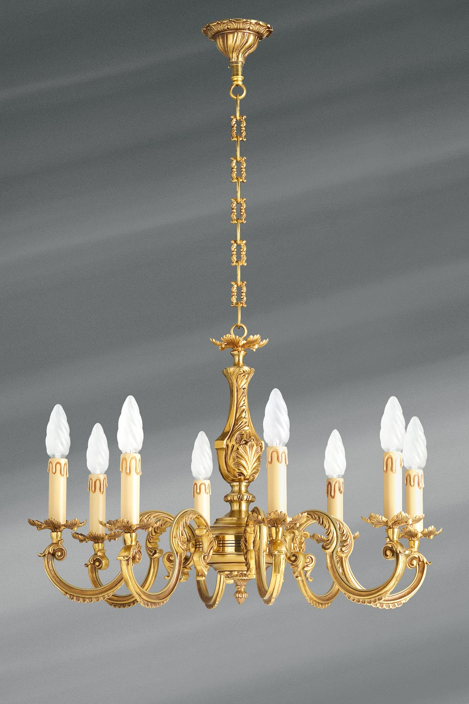 classic chandelier in solid bronze decorated with acanthus leaf motifs old gold patina keys leaf bobeches