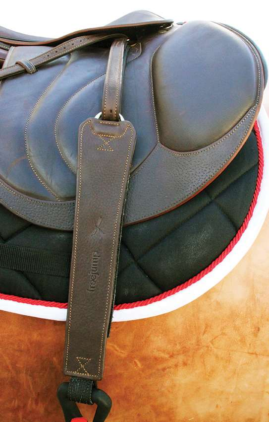 Freejump Stirrups Leathers Pro Grip in Brown shown on Saddle