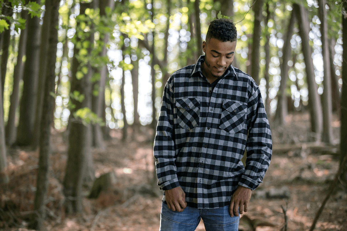 Image of a man in the wood wearing flannel shirt