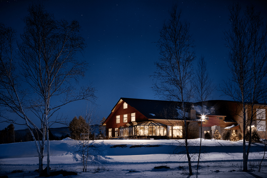 Image of bierhall lit up and looking warm on a cold winter night