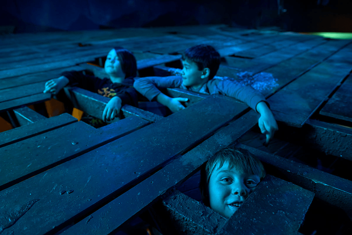 Image of children playing on a replica shipwreck