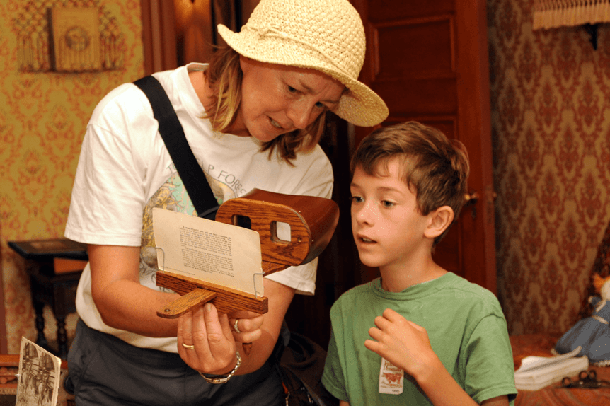 Image of a mother and son looking at a stereoscope