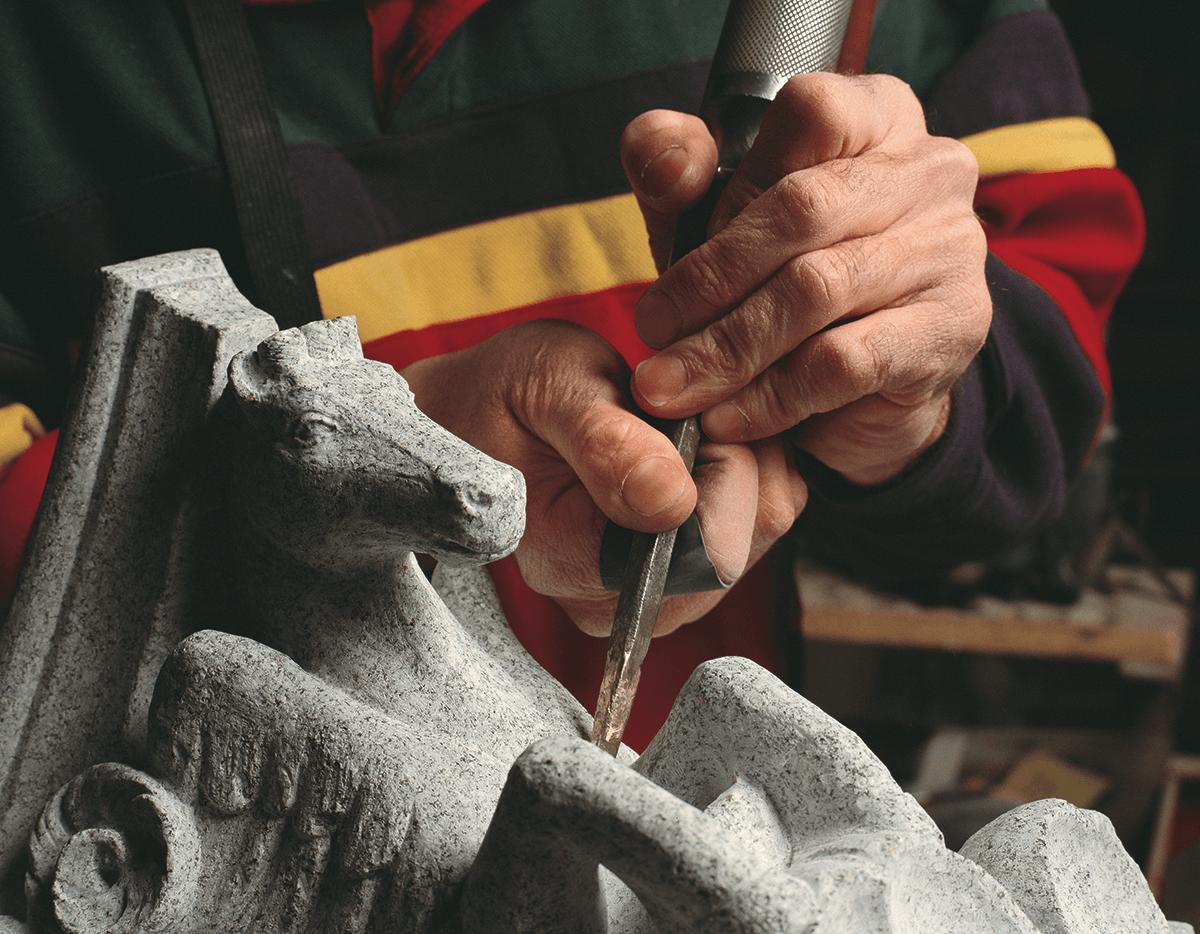Image of granite sculptor at work