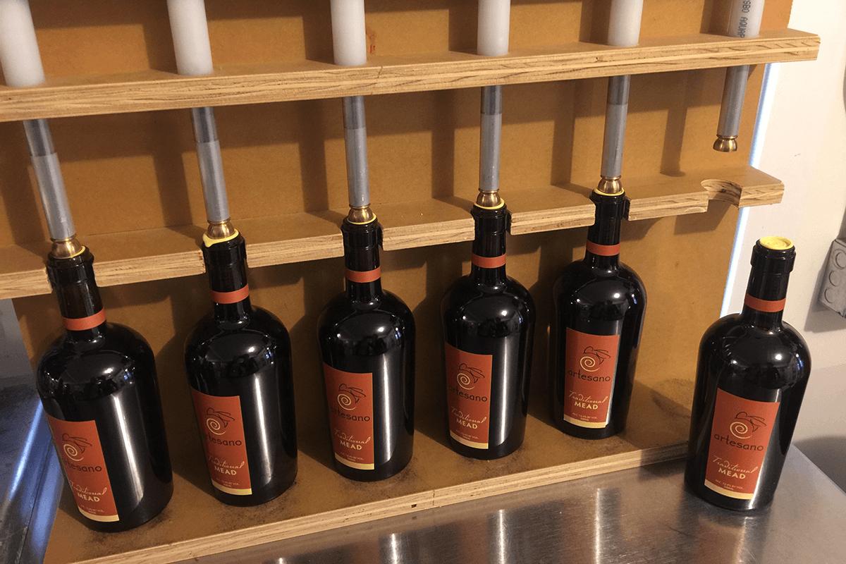 Image of bottles being filled at Artesano