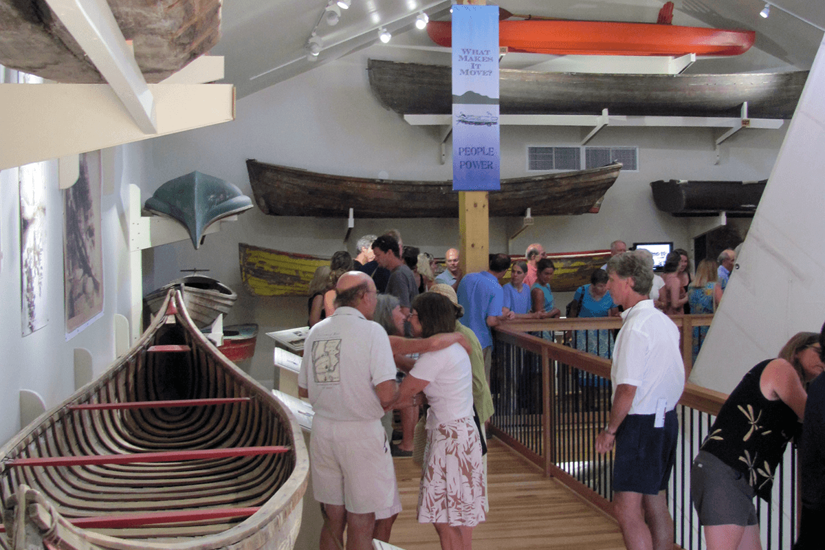 image of people looking at antique boats