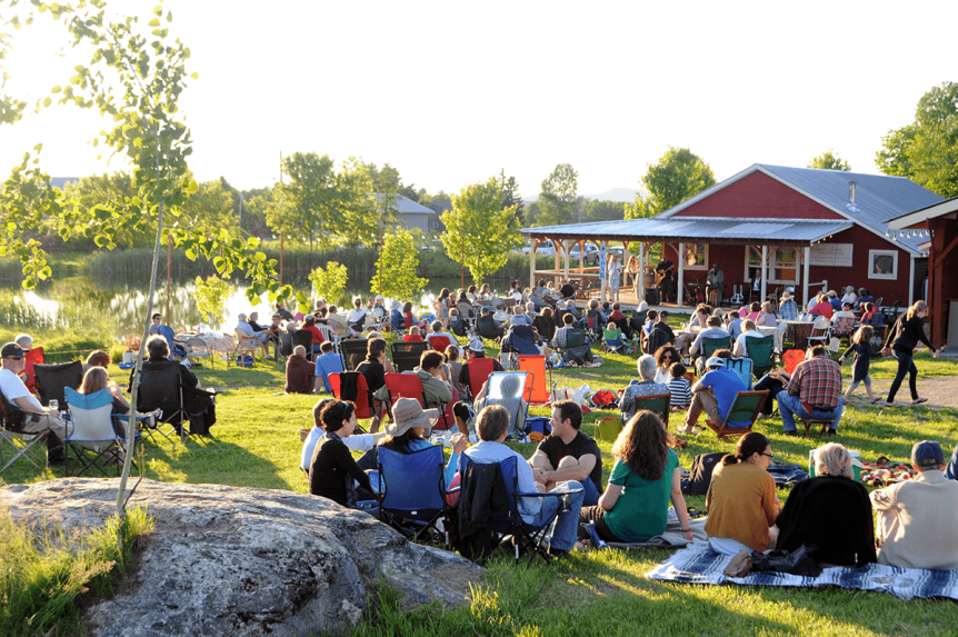 Image of a concert on the lawn at Lincoln Peak Vineyard