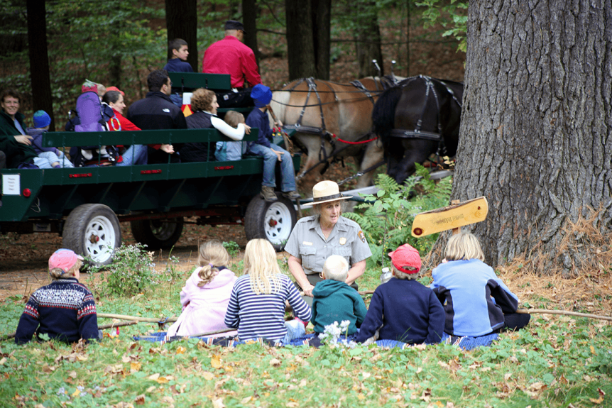 Image of ranger speaking with a group of children outside