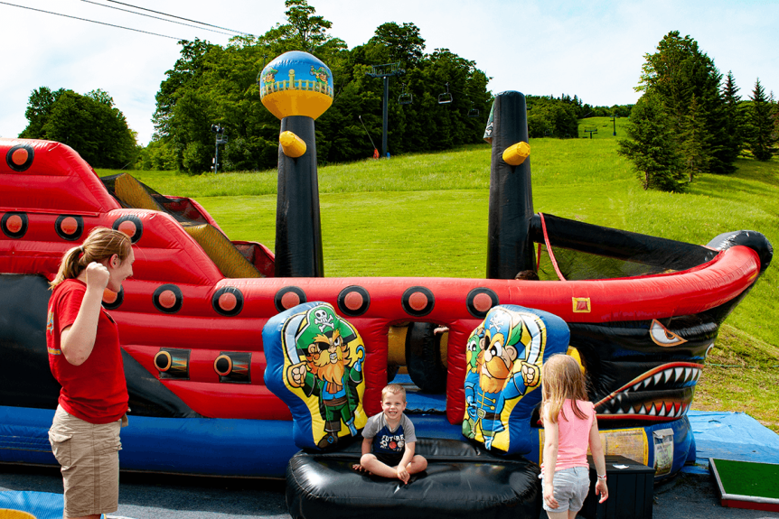 Image of children and bouncyhouse
