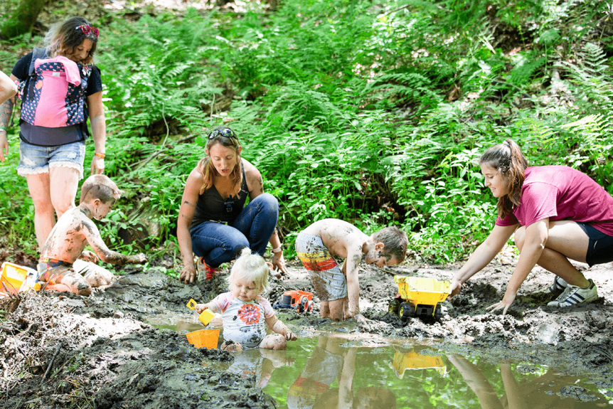 Image of kids playing in the mud