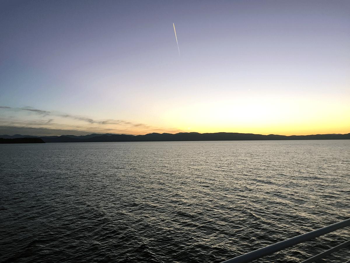 Image of sun setting over New York across Lake Champlain