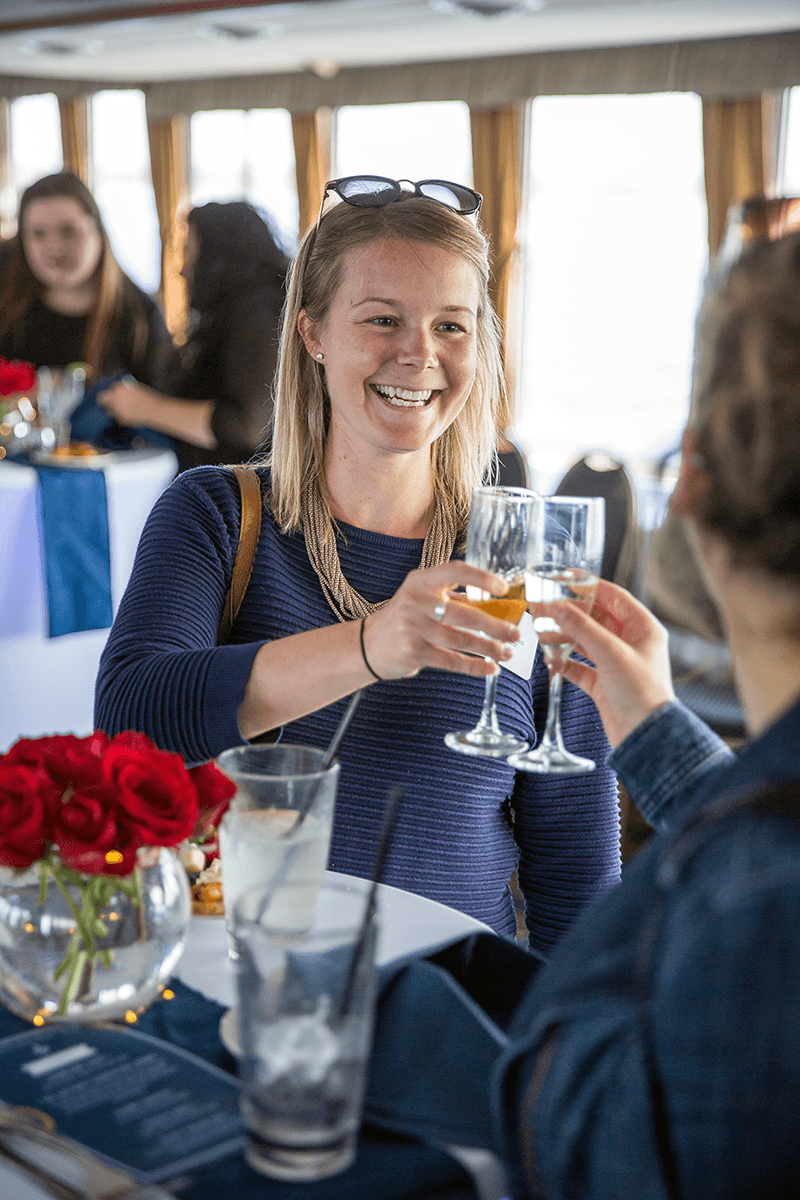 Image of a woman toasting aboard Spirit of Ethan Allen
