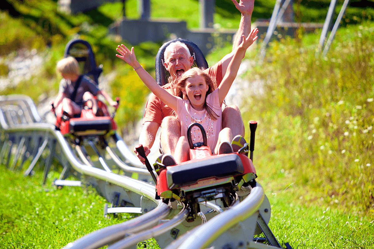 Image of father and daugher on alpine slide at Okemo Mountain Resort