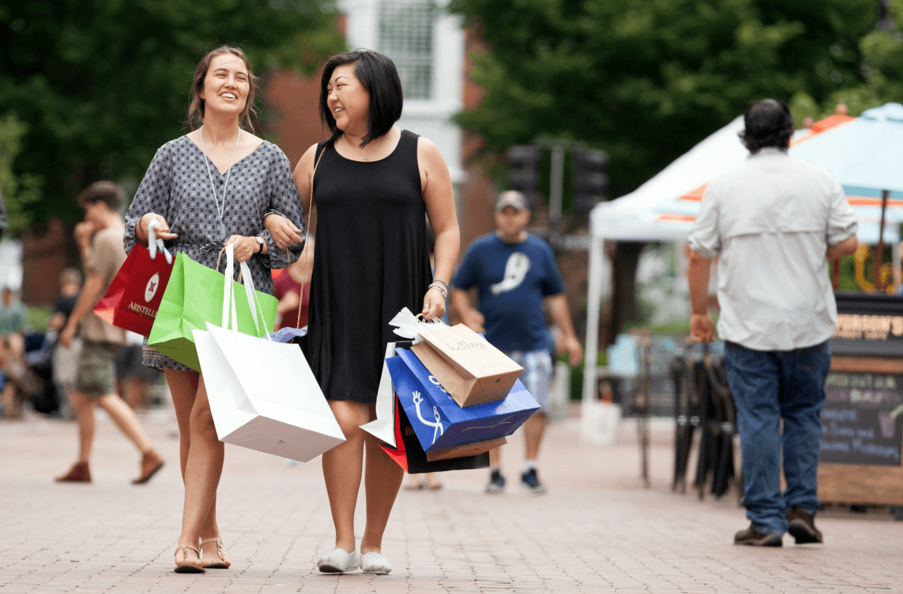 Image of women walking with shopping bags on Church Street Marketplace
