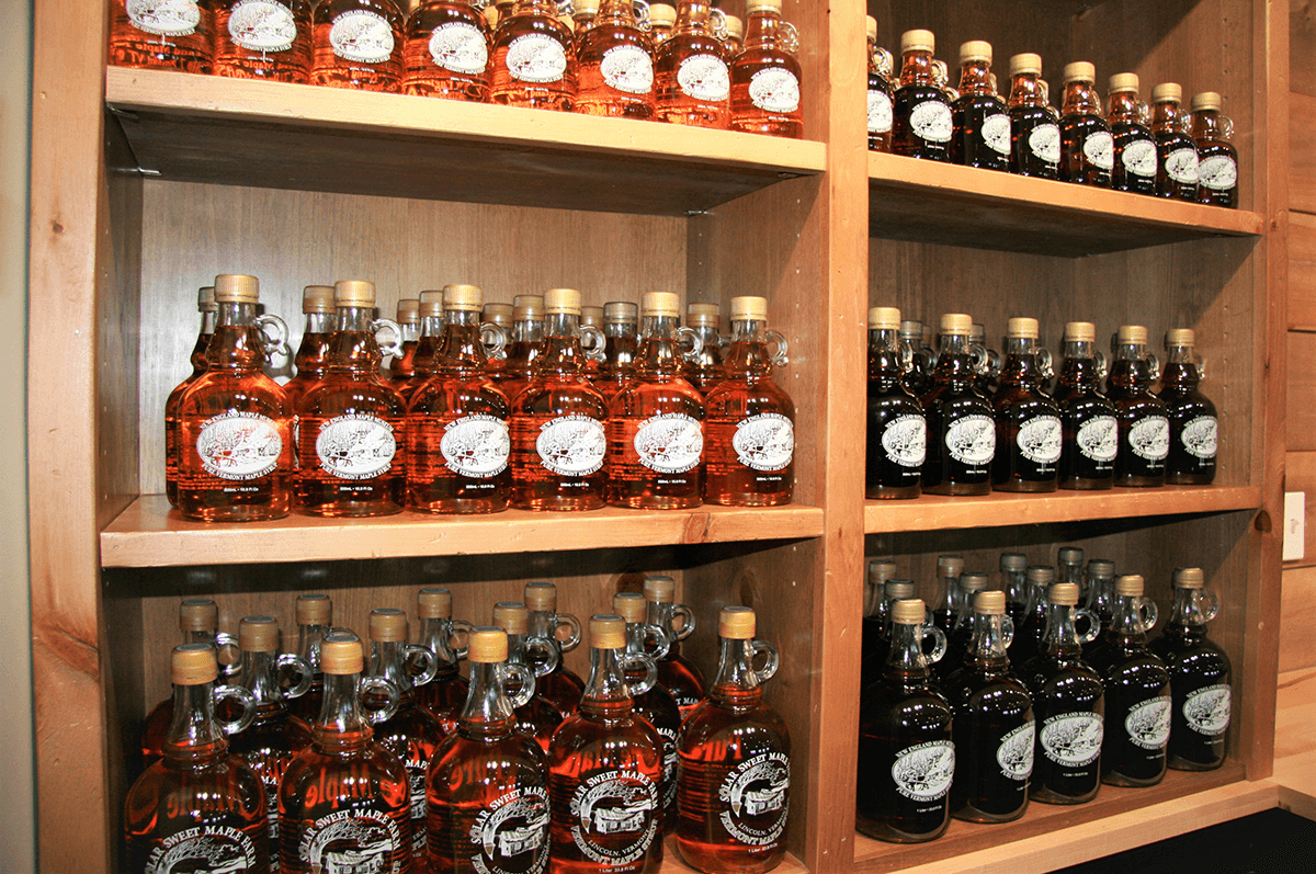 Image of shelves of maple syrup at New England Maple Museum