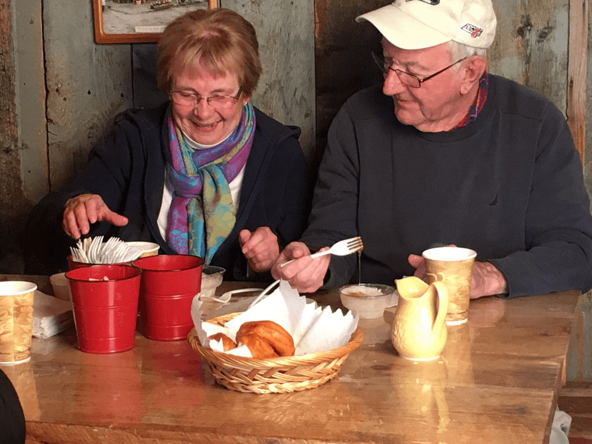 Image of couple enjoying sugary treats at Morse Farm Sugarworks