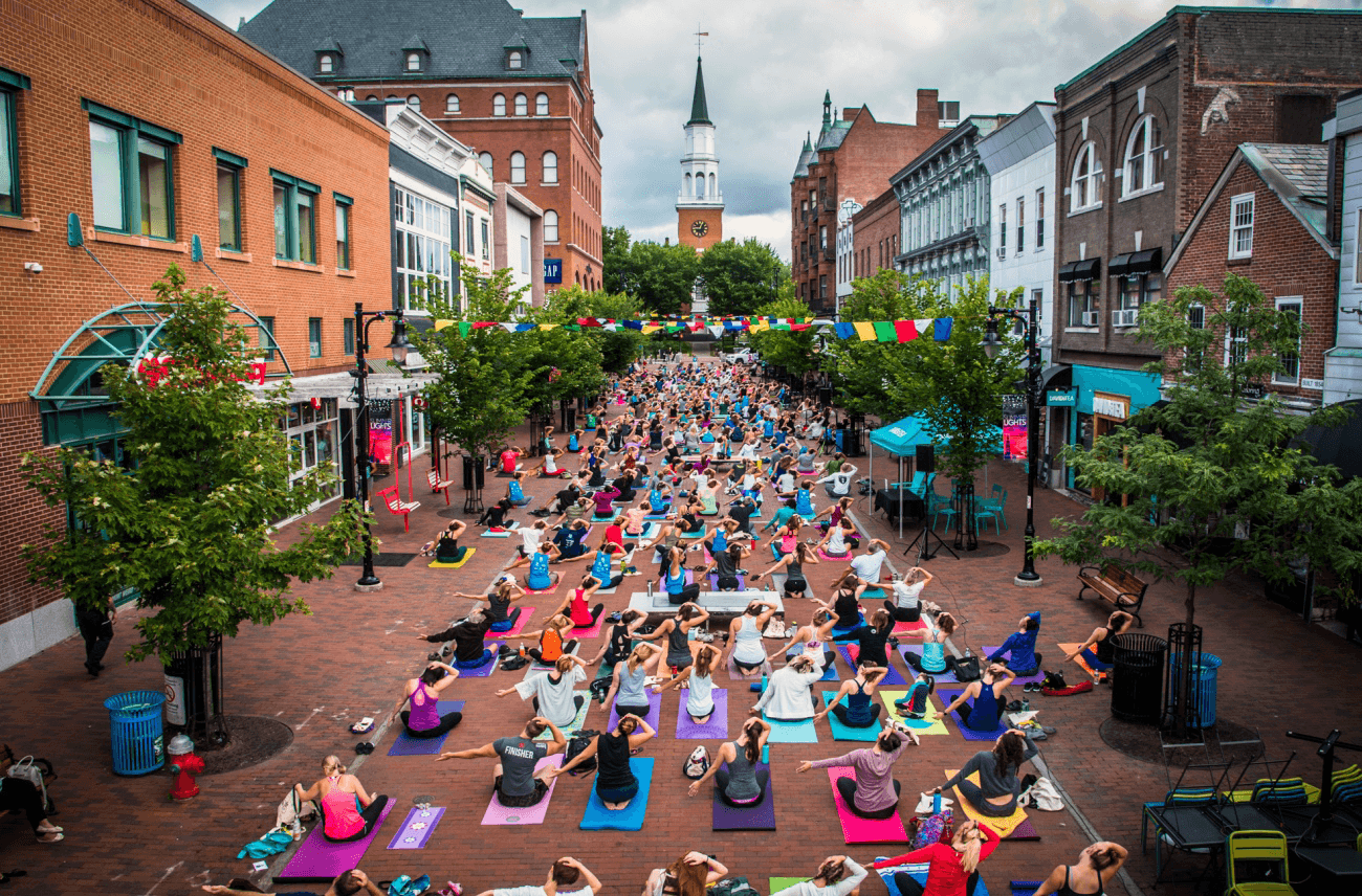 Image of people doing yoga on Church Street Marketplace