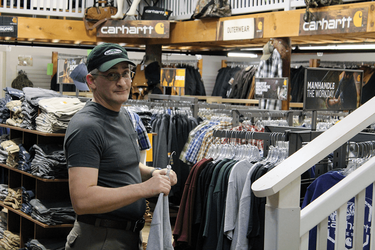 Image of man looking at Carhartt clothing at Farm-Way