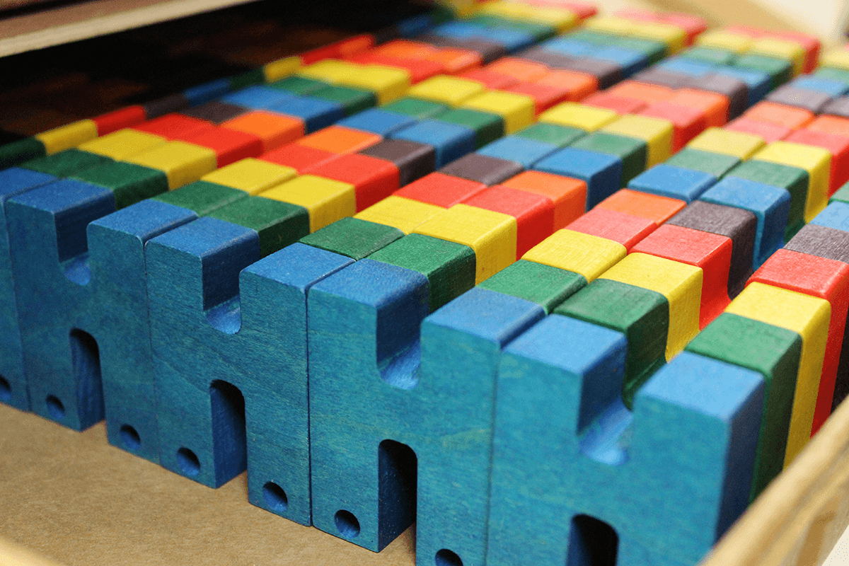 Image of colorful wooden toys at Maple Landmark Woodcraft
