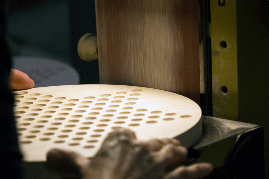 Image of man sanding a Chinese Checkers board at Maple Landmark Woodcraft