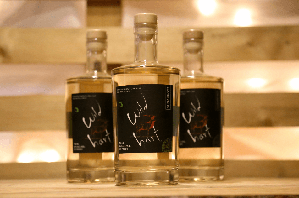 Image of 3 bottles of spirits from Wild Hart Distillery