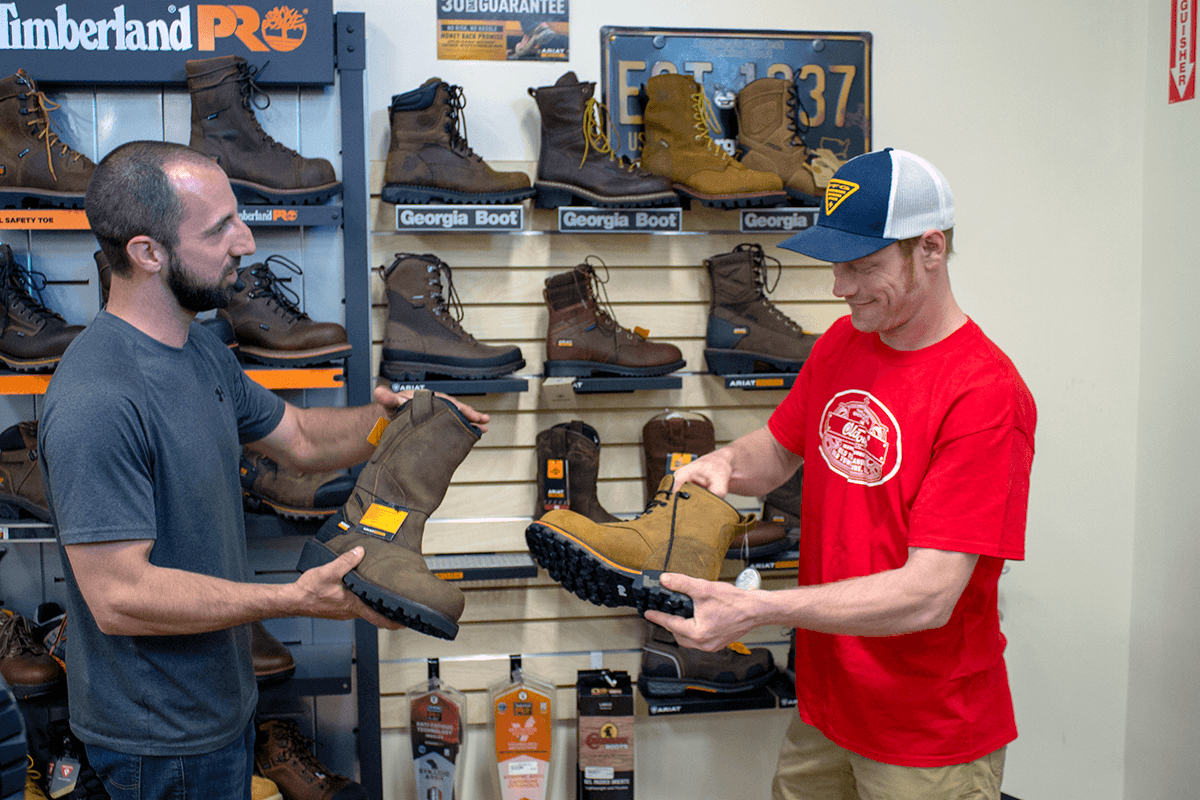 Image of man shopping for workboots at Farm-Way