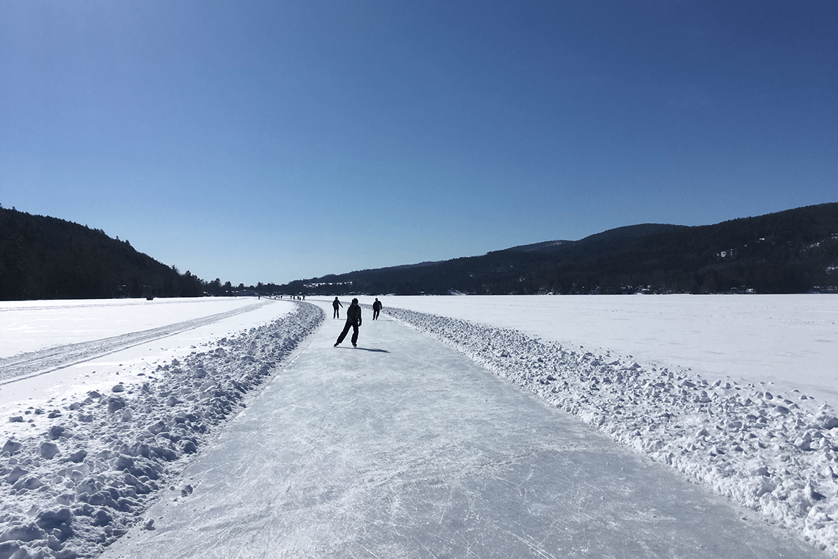 Image of people skating on open ice on the pond at Lake Morey Resort