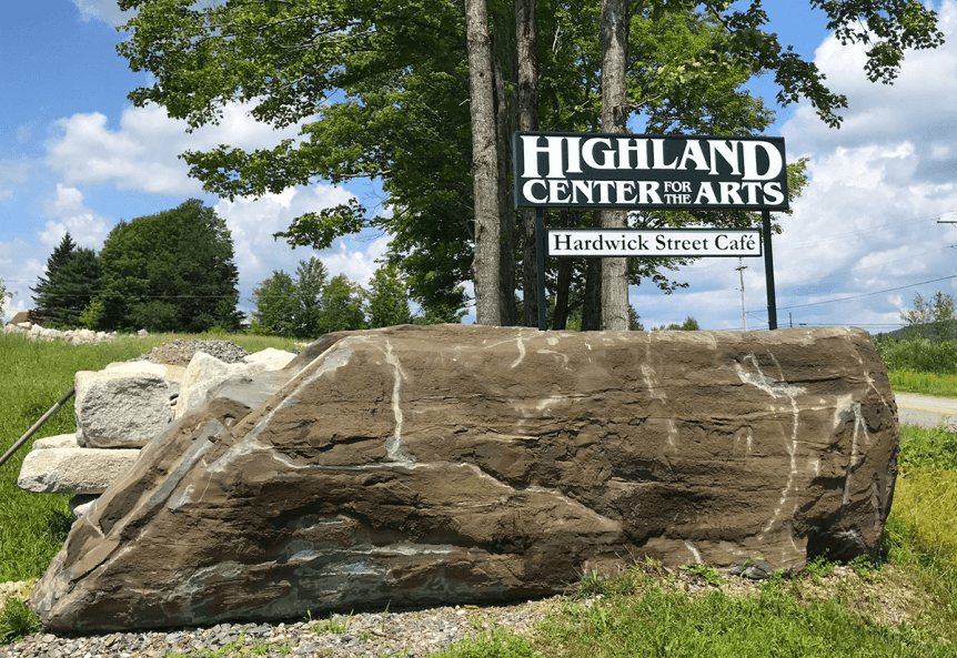 Image of sign and large rock at Highland Center for the Arts