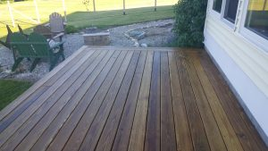 The end results of a pressure wash for a deck in Bristol, VT