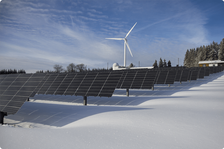 Large scale solar panel array in a snowy field in Vermont