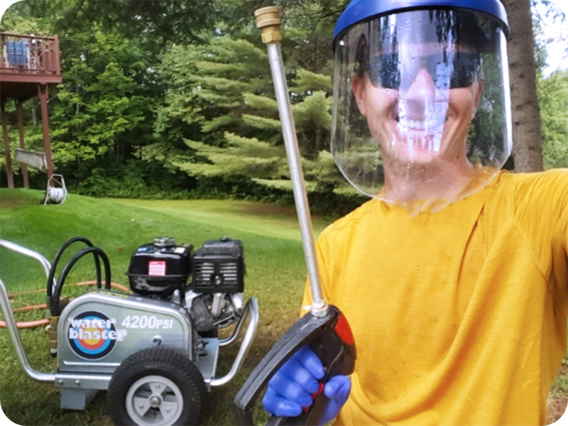 The owner of Vermont Home Wash with a power washing lance and pressure machine