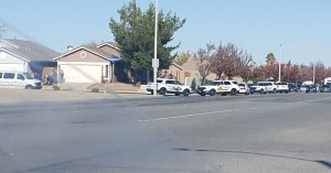 A Victor Valley News member captured a ell phone picture of police taking one of the three suspects into custody. (photo by Michelle Long)