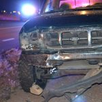 Green Ford Ranger with front damage stopped along the shoulder. (Photo by Diana Cabral, Victor Valley News)