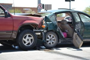 A Red Ford Explorer rear ended a green Volkswagen at the Intersection of Central and Bear Valley. (Photo by Diana Cabral, VictorValley News)